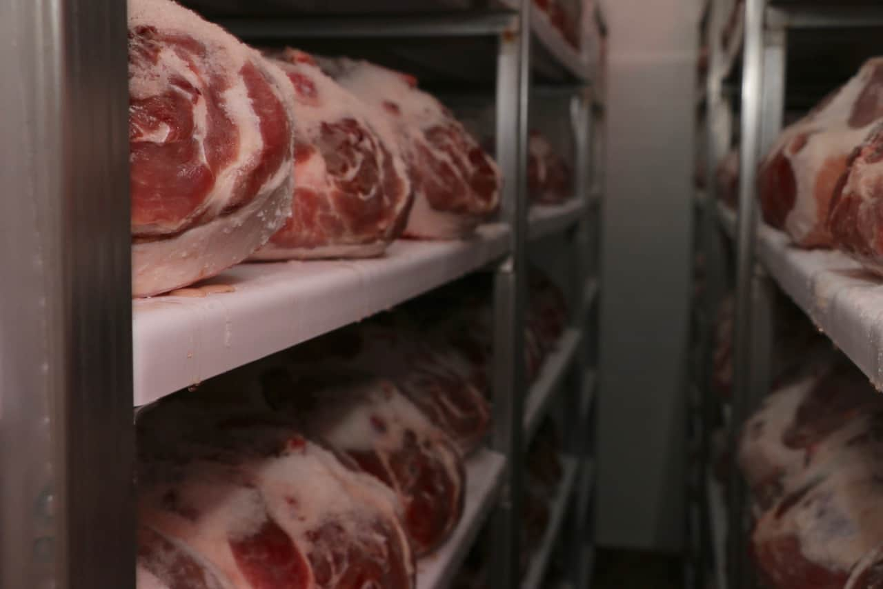 Hams resting in a salting room